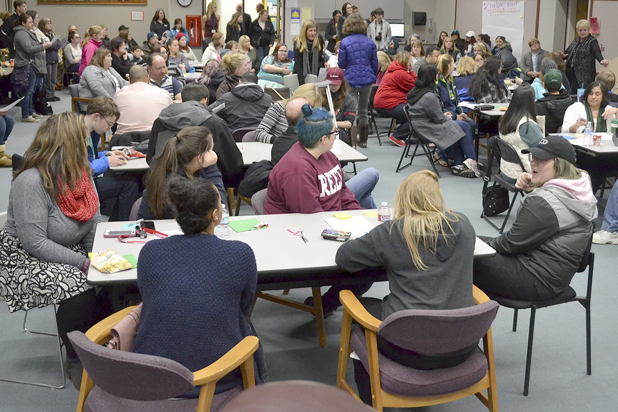 Superintendent Becky Berg, right, talks to a packed crowd in the school board room at the Marysville School District office. (Steve Powell/Staff Photo)